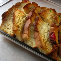 Portuguese Bread French Toast Recipe - This yummy toast is baked in the over rather than on top of it and it 's wonderful. Portuguese sweet bread lines the baking dish. The milk, egg and fragrant spice mixture is poured on top, and then the whole delicious thing is baked until a custard sets.