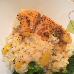 Baked Salmon with Tropical Rice Recipe - This baked salmon preparation is an appealing low calorie main dish. Seasoned with brown sugar, cilantro and lemon-pepper, and paired with white rice flavored with mangos, cilantro, and lemon zest, it makes a satisfying meal.