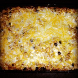 Southwestern Chicken and Rice Casserole Recipe - This souped-up casserole features chicken, corn and rice, mixed with Pace(R) Chunky Salsa and Campbell's(R) Condensed Cream of Chicken Soup that is baked until hot and bubbly and topped with a Mexican cheese blend.
