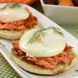 Smoked Salmon Dill Eggs Benedict Recipe - This non-traditional eggs Benedict foregoes the hollandaise in favor of a simple dill butter.
