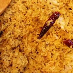 Exotic Indian Tangy Rice Recipe - A tangy rice dish made with tamarind and curry leaves has a slightly sour flavor. It is very easy to make and it a favorite food in south India.