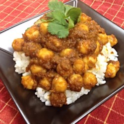 Chana Masala (Savory Indian Chick Peas) Recipe - Making a paste of onion, tomato, chile pepper, ginger, and garlic starts you on your way to a relatively simple homemade Indian dish.