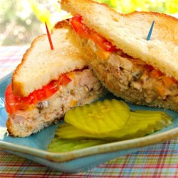 Spicy Tuna Fish Sandwich Recipe - Kick up your tuna salad sandwiches by adding jalapeno peppers and Cheddar cheese crumbles to the mix!