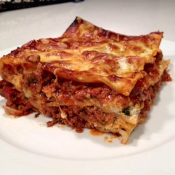 Kim's Lasagna Recipe - A big baked lasagna features Italian sausage, ground beef, and 3 kinds of Italian cheeses plus a homemade red sauce for a family-pleasing dinner that's great for a big group or for company.