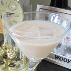 Carrot Cake Martini Recipe - Irish cream liqueur, cinnamon schnapps, and butterscotch schnapps are shaken together creating a sweet carrot cake-flavored martini.