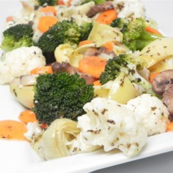 Marinated Vegetable Medley Recipe - Fresh broccoli, cauliflower, carrots, mushrooms and artichokes heats are succulent when draped in this slightly sweet herb vinaigrette.