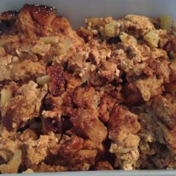 Slow Cooker Apple Cinnamon Bread Pudding Recipe - All the fixings for bread pudding and apple pie are cooked together in the slow cooker creating a rich and custardy apple bread pudding.