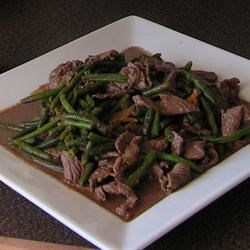 Thit Bo Xao Dau Recipe - This quick Vietnamese stir-fry of sirloin tip slices is combined with fresh green beans and served over rice for a one-dish meal. Other vegetables, such as broccoli florets,  could be substituted for the beans.