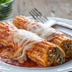 Creamy Italian Sausage Manicotti Recipe - Creamy mozzarella and savoury sausage baked to perfection.