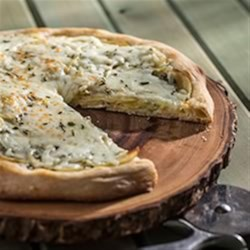 Creamy Rosemary, Garlic and Potato Pizza Recipe - For the pizza and potato lover in all of us.