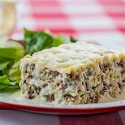 Creamy White Chicken and Artichoke Lasagne Recipe - This white lasagne is stuffed with chicken, artichokes and creamy mozzarella.