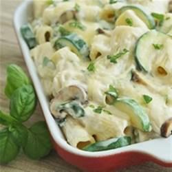 Creamy Zucchini and Spinach Rigatoni Recipe - Rigatoni pasta, mushrooms, spinach, and zucchini are baked in a creamy cheese sauce.
