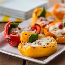 Grilled Summer-Fresh Peppers Recipe - Favourite flavour combo of tomatoes, basil and mozzarella - stuffed into and grilled in fresh pepper shells.