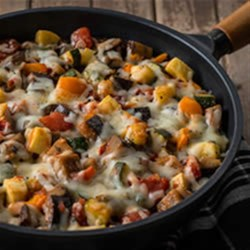 Cheesy Ratatouille Recipe - Classic slow-roasted ratatouille flavour of zucchini, eggplant and peppers made easy for any night.