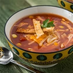 Tortilla Chicken Soup Recipe - Your favourite Mexican flavours of corn, cilantro, tortillas, salsa and cheese in an easy-to-make soup.