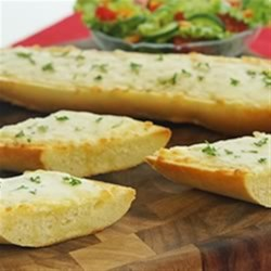 Herb and Garlic Cheese Bread Recipe - Serve as a tasty appetizer, or as a cheesy side with your favourite soup or salad.