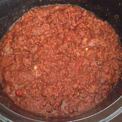 Slow Cooker Ground Beef Barbecue Recipe - Serve this classic sloppy joe over hot dogs and piled onto hamburger buns. Everyone will love it, and you'll love that it cooks in the slow cooker while you do other things.