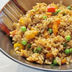 Vegetable Fried Rice Recipe - This dish combines the nutty flavor of brown rice with the fresh taste of bell peppers, baby peas, and other vegetables.