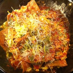 Easy Microwave Chilaquiles Recipe - This recipe is a speedy alternative to the more traditional Mexican breakfast dish. Enchilada sauce, tortilla chips, and Mexican cheese are assembled in layers, and then heated in the microwave to meld the flavors together.