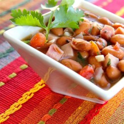 Easy Cowboy Beans (Frijoles Charros) Recipe - Pinto beans, diced tomatoes with green chile peppers, and ham are simmered together in this easy cowboy beans recipe. Serve with warm tortillas or cornbread.