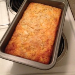 Corn Casserole Recipe - Creamed corn baked with eggs, margarine, corn bread mix and onion. Simple and satisfying.
