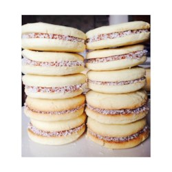 Alfajores Argentinean Style Recipe - Small vanilla and lemon cookie sandwiches, filled with caramel, and rolled in coconut, are a traditional sweet, much loved in most Latin cultures.