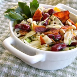 Bean and Bacon Salad Recipe - Kidney beans, cabbage, and bacon are a great combination of flavors and textures. This crowd-pleasing salad brings them together with a creamy vinaigrette dressing.