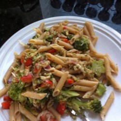 Penne with Red Pepper Sauce and Broccoli Recipe - A delicious combination of red pepper sauce, fresh basil, almonds, broccoli florets, and pasta.