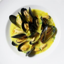 Saffron Mussel Bisque Recipe - Mussels cooked in white wine are incorporated into this chicken stock-based bisque seasoned with fenugreek and saffron.