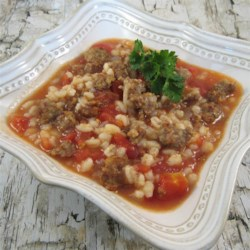Mom's Italian Beef Barley Soup Recipe - Cubed beef, barley, onion and tomato sauce are cooked in a slow cooker with water and beef bouillon in this easy soup.