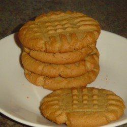 Favorite Peanut Butter Cookies  Recipe - Simple peanut butter cookies with the traditional crisscross on the top.