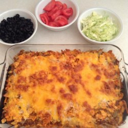 Easy Taco Casserole Recipe - Ground beef mixed with salsa and onion is layered into a casserole with crushed tortilla chips and cheese in this Mexican-style dinner idea.