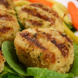 Grilled Garlic Parmesan Crusted Scallops Recipe - Succulent scallops are coated with Parmesan cheese and breadcrumbs before being grilled to a perfect golden brown.