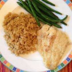 Cheesy Catfish Recipe - This savory catfish dish is coated in Parmesan cheese and baked.  Excellent for an easy family dinner!  A fish dish even your kids will love!
