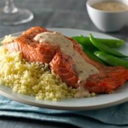 Grilled Salmon with Roasted Garlic Sauce Recipe - Grilled salmon served with a delicious garlic sauce makes for a perfect dinner--quick and easy to prepare.