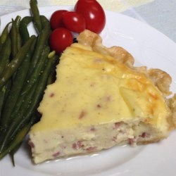 Swiss Ham Pie Recipe - Savory ham pie made with Swiss cheese and a rich filling is a quick and easy comfort food to serving at brunch on Easter morning.