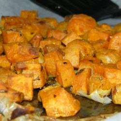 Low-Cal Roasted Sweet Potato Bites Recipe - Roasted sweet potato bites seasoned with rosemary and thyme are a nice substitute for hash browns or a perfect side dish on Thanksgiving or Christmas.
