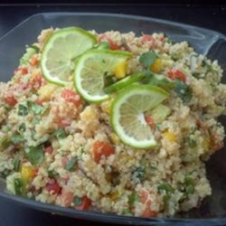 Tropical Quinoa Salsa Salad Recipe - Quinoa combines with tropical fruit salsa ingredients in a spunky salad with a lime-pineapple vinaigrette.