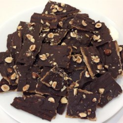 Delicious Matzo Candy Recipe - Simple matzo crackers are transformed into a crisp toffee treat when topped with caramel, chocolate, and nuts.