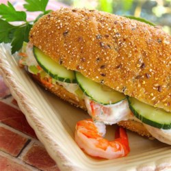 Prawn Banh Mi Recipe - A prawn banh mi is a Vietnamese-inspired sandwich with a cilantro sauce, pickled vegetables, and prawns layered in a baguette.