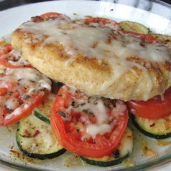 Baked Chicken and Zucchini Recipe - Baked chicken breasts with zucchini, tomatoes, and fresh basil: colorful and tasty, and ready in less than an hour!