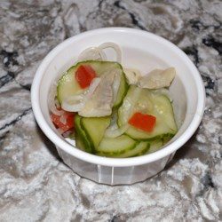 Pickled Herring and Cucumber Salad Recipe - If you like cucumber and pickled herring, here is a recipe for the combination of the two in a summertime salad.