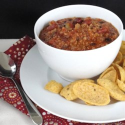 Jay's Spicy Slow Cooker Turkey Chili Recipe - Jay's spicy slow cooker turkey chili has a perfect combination of seasonings, chile peppers, beans, and turkey that is a great addition to football-watching parties, tailgating, or cold winter evenings.