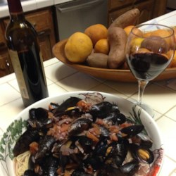 Melissa's Mussels Recipe - Serve these mussels as an appetizer with some crusty bread or as a meal over linguini. It is sure to please mussel lovers!