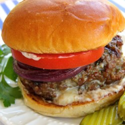 Grilled Gorgonzola-Basil Burgers Recipe - Tangy Gorgonzola, fresh basil, and a dash of onion enrich the flavor of luxurious ground sirloin burgers.