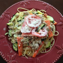 Springtime Spaghetti Recipe - Zucchini and carrots are sauteed in butter, mixed in a creamy sauce, and tossed with spaghetti. This is a great side dish that goes really well with barbeque.