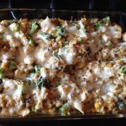 Quick Chicken and Stuffing Casserole Recipe - Chicken, broccoli, stuffing, and Cheddar cheese are baked into a warm and comforting casserole perfect for weeknight dinner.