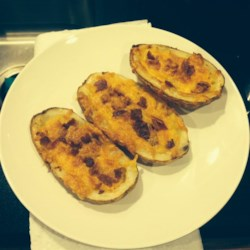 Potato Skins Recipe - Gouda cheese is piled generously on baked potato skins along with pepperoni and green onions.