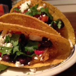 Megan's Spaghetti Squash Tacos Recipe - Spaghetti squash seasoned with chili powder and lime is combined with black beans for a delicious, low-fat alternative to beef tacos.