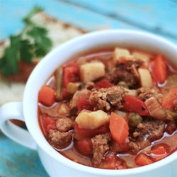 Easy Vegetable Beef Soup Recipe - Canned vegetables and tomatoes added to browned ground beef and onions simmer for 3 to 4 hours for a very easily prepared lunch or supper dish. Add bread and salad, and you have it!